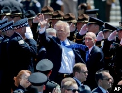 President Donald Trump waves as he leaves after speaking at the 36th Annual National Peace Officers memorial service, May 15. 2017, on Capitol Hill in Washington.