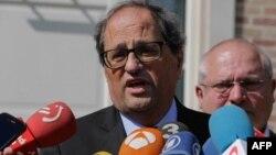 Le président régional catalan Quim Torra s'entretient avec les médias à Waterloo en Belgique, le 30 mai 2018.