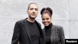 Janet Jackson dan suaminya Wissam Al Mana di Pekan Mode Milan, 2013. (Reuters/Alessandro Garofalo)