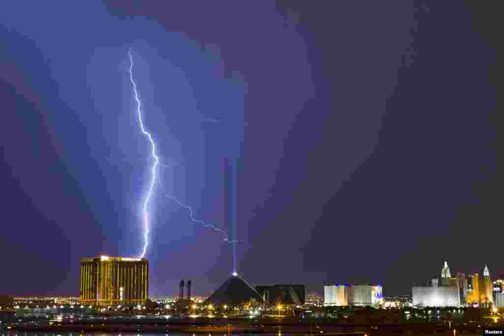 Lightning strikes above the Mandalay Bay (L) and Luxor (C) casinos on the Las Vegas Strip as a thunderstorm moves through Las Vegas, Nevada, USA, July 20, 2013.