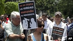 Journalists protest outside the office of the state of Veracruz's representative in the capital to protest the killing of photojournalists Esteban Rodriguez, Gabriel Huge and Guillermo Luna in Mexico City, May 4, 2012.