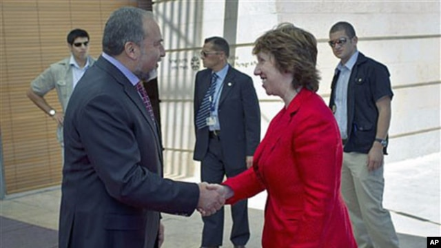 Israel's foreign minister Avigdor Lieberman (L) welcomes European Union's foreign policy chief Catherine Ashton prior their meeting at the foreign ministry in Jerusalem, September 14, 2011