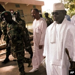 Gambian President Yahya Jammeh (2nd R) leaves a polling station after casting his ballot in the presidential elections in Banjul (File)