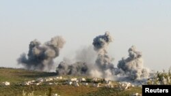 FILE - Smoke rises after what activists said was an airstrike in northern Syria March 8, 2015.