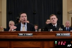 FBI Director James Comey, left, and National Security Agency Director Michael Rogers, right, testify on Capitol Hill in Washington before the House Intelligence Committee hearing on allegations of Russian interference in the 2016 U.S. presidential election, March 20, 2017.