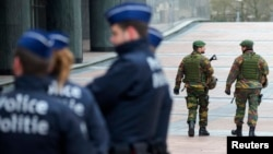 Belgian soldiers patrol outside the European Council headquarters in central Brussels, Jan, 21, 2015.