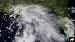 A photo provided the the National Oceanic and Atmospheric Administration shows the tropical low pressure system in the Gulf of Mexico, September 1, 2011 at 2015 UTC.