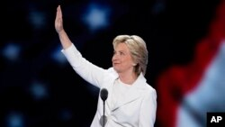 FILE - Democratic presidential nominee Hillary Clinton waves to delegates before speaking during the final day of the Democratic National Convention in Philadelphia, July 28, 2016.