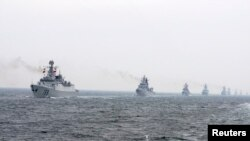 FILE - Chinese Navy warships take part in an international fleet review.