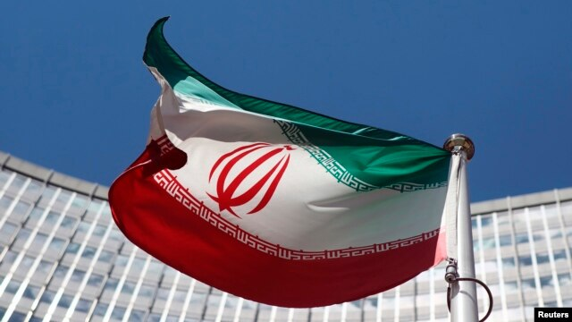 FILE - An Iranian flag flutters in front of the United Nations headquarters in Vienna, June 17, 2014.