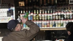 A Russian man drinking near a liquor seller in Moscow last year