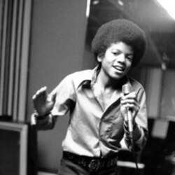Michael Jackson at age 13, the youngest member of his family's singing group the Jackson Five