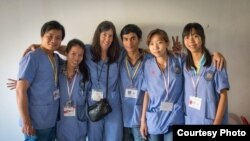 Doctors who volunteered at a medical mission organized by the Cambodian Health Professionals Association of America (CHPAA) posed in a group photo in Battambang, Cambodia, 2014. (Courtesy of CHPAA)