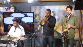 Tosin (left), along with his band members, perform in studio on VOA's African Beat radio show.