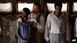 "This image released by Fox Searchlight shows Lupita Nyong'o, from left, Michael Fassbender and Chiwetel Ejiofor in a scene from ""12 Years A Slave."""