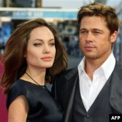 "U.S. actor Brad Pitt and his girlfriend U.S. actress Angelina Jolie arrive for the screening of the movie "" The Assassination of Jesse James by the coward Robert Ford"" at the 33rd American Film Festival in Deauville, Normandy, France, Monday Sept. 3, 2007"