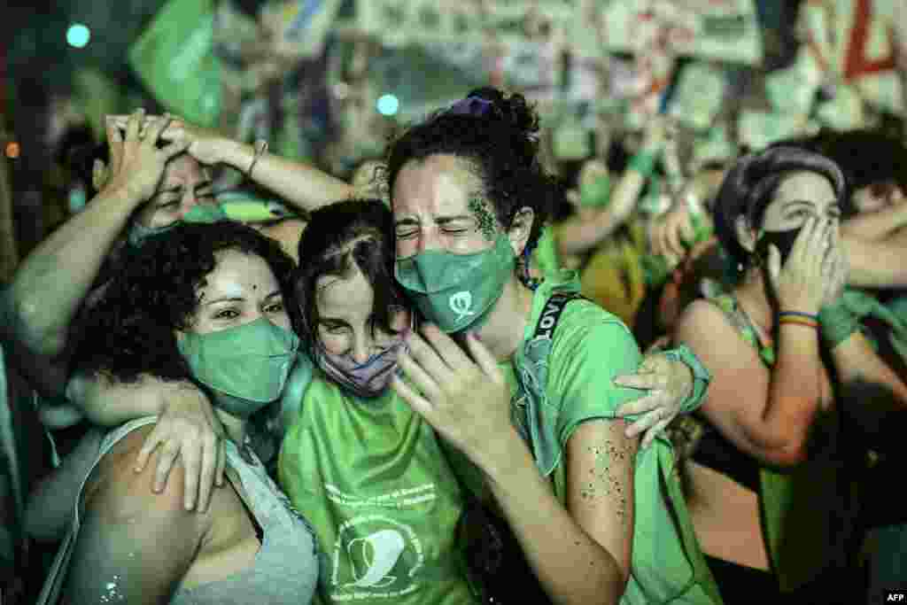 Pro-choice activists celebrate after the Senate approved a bill to legalize operations to end pregnancies, outside the Congress in Buenos Aires, Brazil.