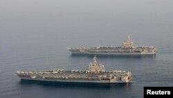 美中两国的海军官员曾提议美国派遣一艘航空母舰访问中国。