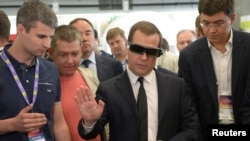 Russian Prime Minister Dimitry Medvedev (C) takes part in a conference for startups and investors at the Skolkovo Innovation Center just outside Moscow, May 28, 2013.