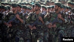 FILE - Members of Iran's Revolutionary Guards march during a military parade to commemorate the 1980-88 Iran-Iraq war in Tehran, Sept. 22, 2007.