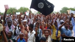 FILE - Pro Al-Shabaab demonstrators attend a protest in Somalia.