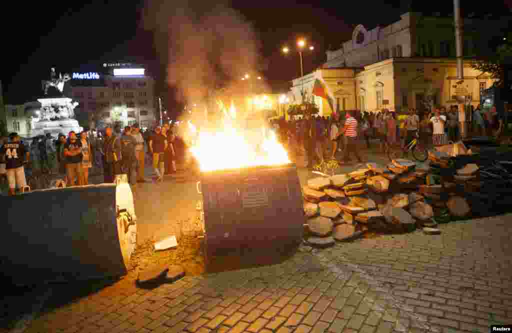 Protesters burn a barricade outside the parliament building in Sofia, Bulgaria, July 24, 2013.