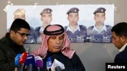 Safi al-Kaseasbeh, center, father of Islamic State captive Jordanian pilot Mu'ath al-Kaseasbeh, stands before a news conference where he asked Islamic State fighters to pardon and release his son, in Amman, Feb. 1, 2015.