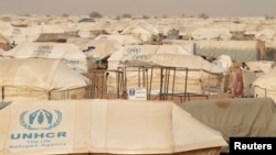 FILE - The Mbera refugee camp in southern Mauritania was set up for people fleeing violence in northern Mali and is home to more than 64,000 people, May 23, 2012. It was the unlikely site of a concert of Malian music.