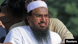 Hafiz Saeed, head of Jamaat-ud-Dawa charity and founder of Lashkar-e-Taiba, attends an anti-U.S. rally in Peshawar, Pakistan, October 1, 2012.
