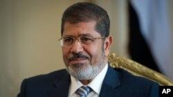 Presiden Mesir Mohammed Morsi berjanji akan membatasi kekuasaan absolut Presiden dalam pertemuan dengan Dewan Kehakiman Agung Mesir (foto: dok).