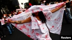 A woman during a demonstration holds sheet to demand justice for women who are the victims of violence in Mexico City, Mexico.