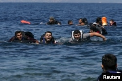 A refugee shouts as he swims towards the shore after a dinghy carrying Syrian and Afghan refugees deflated some 100m away before reaching the Greek island of Lesbos, September 13, 2015.