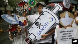 Protesters display slogans during a rally against the controversial immunization of more than 700,000 Filipino children with the anti-dengue vaccine Dengvaxia in Manila, Philippines, Dec. 18, 2017. The controversial vaccine, manufactured by Sanofi Pasteur was recently put on hold by the Philippines after new study findings showed it posed risks of severe cases in people without previous infection. The controversy has prompted the Philippine Senate to conduct an investigation.