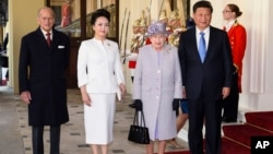 From left, the Duke of Edinburgh, China's first lady, Peng Liyuan, Queen Elizabeth II and the Chinese President Xi Jinping at the Grand Entrance to Buckingham Palace, London.