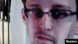 A banner supporting Edward Snowden, a former contractor at the National Security Agency (NSA), is displayed at Hong Kong's financial Central district on June 21, 2013