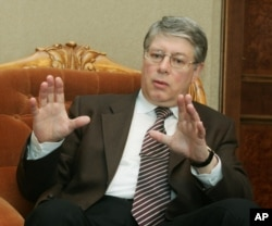 Russian official Alexey Borodavkin gestures as he speaks during an interview with the Associated Press, March 23, 2005, in Vienna.