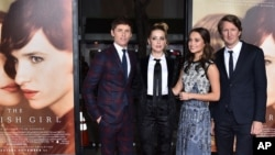 "FILE - From left, Eddie Redmayne, Amber Heard, Alicia Vikander and Tom Hooper arrive at the premiere of ""The Danish Girl"" at Regency Village Theatre, Nov. 21, 2015, in Los Angeles, California."