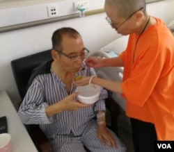In this recent undated handout photo, Chinese dissident and Nobel Prize laureate Liu Xiaobo, left, is attended to by his wife Liu Xia in a hospital in China. The judicial bureau in the northeastern Chinese city of Shenyang says jailed Nobel Peace Prize laureate Liu Xiaobo has died of multiple organ failure Thursday, July 13, 2017, at age 61. (Photo via AP, File)