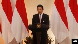 FILE - Japanese Foreign Minister Fumio Kishida delivers a speech during the second Conference on Cooperation among East Asian Countries for Palestinian Development in Jakarta, Indonesia, March 2014.