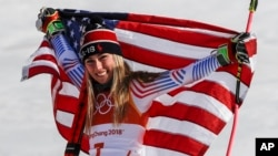 Mikaela Shiffrin, of the United States, celebrates her gold medal in the Women's Giant Slalom at the 2018 Winter Olympics in Pyeongchang, South Korea, Feb. 15, 2018.