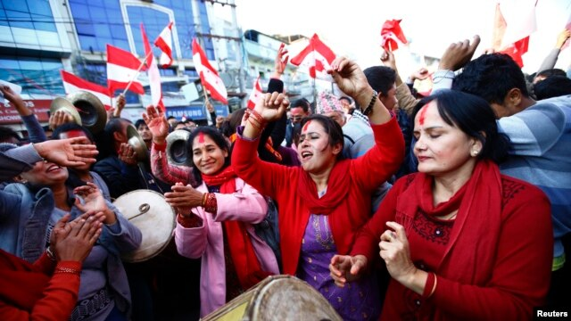 Supporters of Nepali Congress Party cheer as Constituent Assembly Election scores are displayed on a screen in Kathmandu, Nov. 21, 2013.
