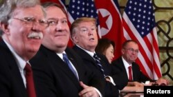 U.S. President Donald Trump, U.S. Secretary of State Mike Pompeo, White House national security adviser John Bolton and acting White House Chief of Staff Mick Mulvaney attend the extended bilateral meeting in the Metropole hotel with North Korea's leader Kim Jong Un.