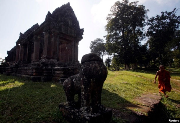 FILE - A Buddhist monk visits the Preah Vihear temple on the border between Thailand and Cambodia, Nov. 12, 2013.