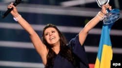 FILE - Ukraine's Jamala reacts on winning the Eurovision Song Contest final at the Ericsson Globe Arena in Stockholm, Sweden, May 14, 2016.