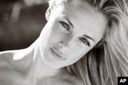 FILE - An undated portfolio photo supplied by Ice Model Management in Johannesburg of Oscar Pistorius' late girlfriend, Reeva Steenkamp, during a photo shoot.