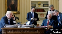 FILE - U.S. President Donald Trump (left to right), joined by Chief of Staff Reince Priebus, Vice President Mike Pence, senior advisor Steve Bannon, and Communications Director Sean Spicer, speaks by phone with Russia's President Vladimir Putin.
