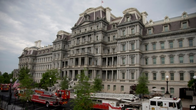 District of Columbia Fire department trucks and personnel are seen parked between the The Eisenhower Executive Office Building and the West Wing as they respond to a call at the White House, May 11, 2013, in Washington.