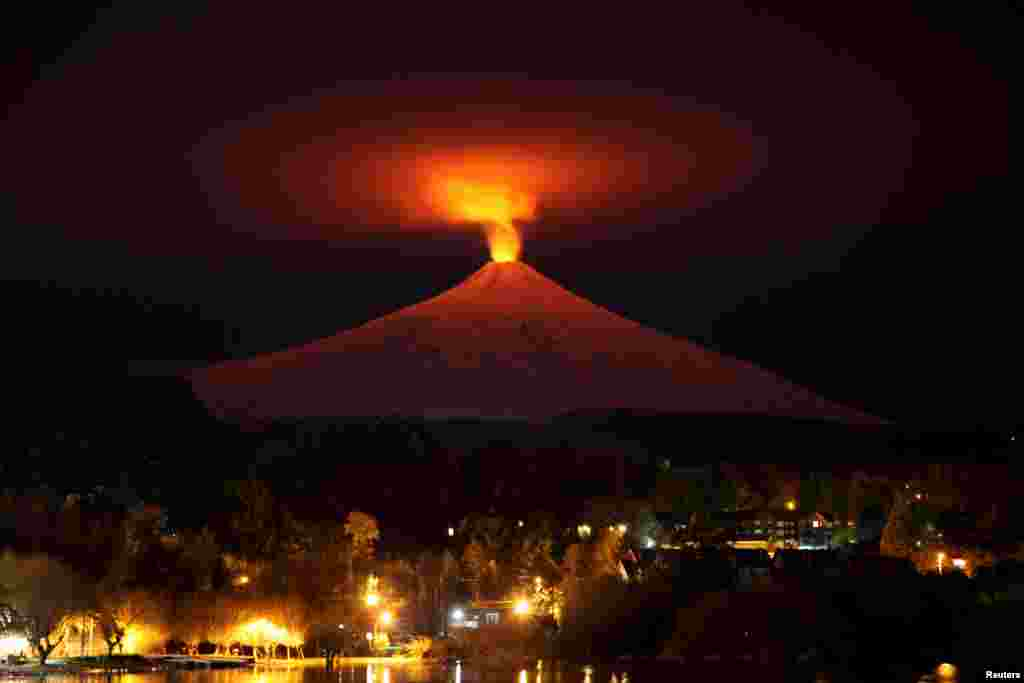 The Villarrica Volcano is seen at night from Pucon town, Chile. Villarrica, located near the popular tourist resort of Pucon, is among the most active volcanoes in South America.