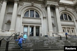 FILE - Children run down the stairs of The Metropolitan Museum of Art in New York, Oct. 2012.