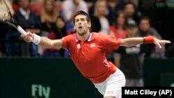 Petenis unggulan teratas AS Terbuka, Novak Djokovic menang mudah atas petenis Lithuania Ricardas Berankis dengan skor 6-1, 6-2, dan 6-2 (foto: dok).